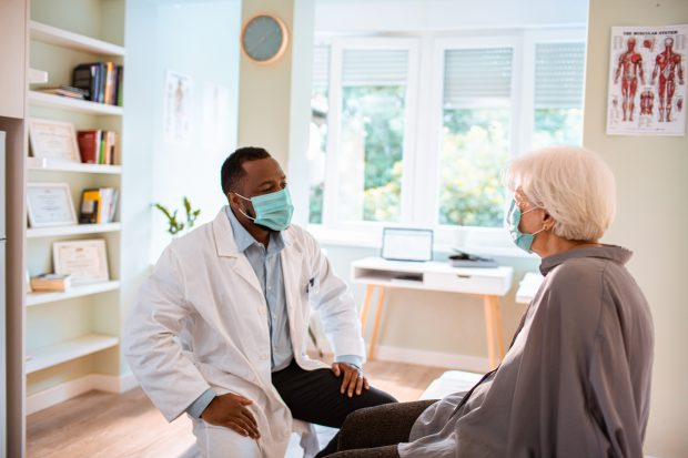 GP in consultation with a patient