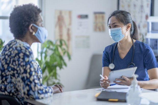 Female doctor meeting patient